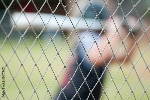 Fotografie, Obraz  Close up of baseball fence