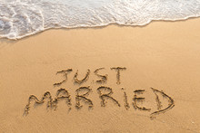 Just Married Written In The Sa...