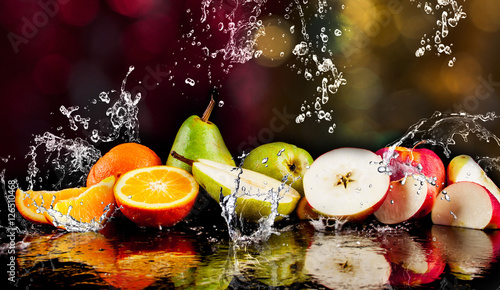 Pears, apples, orange fruits and Splashing water