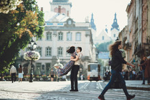 Sweet Moment Of A Couple On The Sunny Square