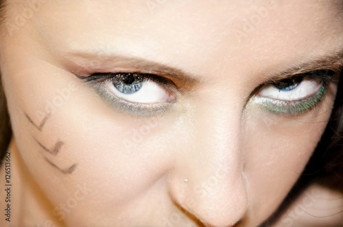Photo  pretty girl with tribal makeup