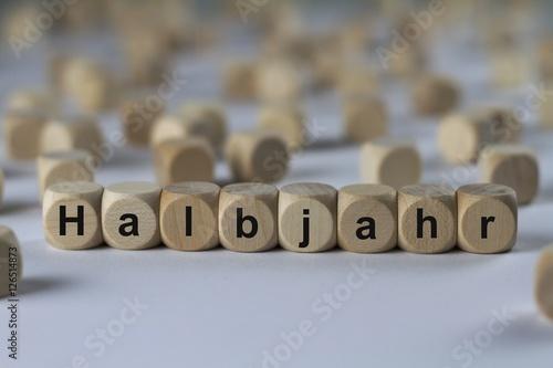 Fotografie, Obraz  Halbjahr - Holzwürfel mit Buchstaben