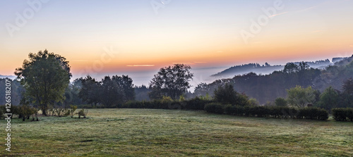 Deurstickers Khaki sunrise in german countryside with hills in the Eifel