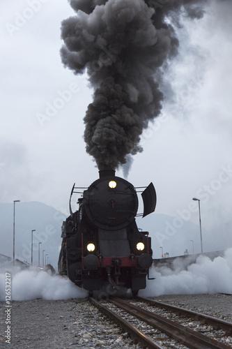 Fototapeta Old Steam Locomotive driving and leaving smoke and vapour obraz na płótnie