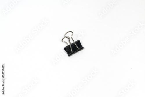 Fotografie, Obraz  Black Paper clip (Binder clip) on white background
