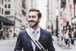 USA, New York City, smiling businessman in Manhattan