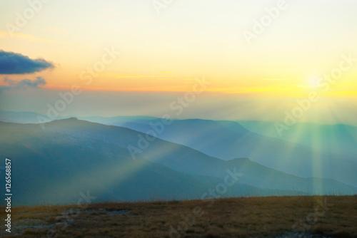 Foto auf Leinwand Hugel Beautiful sunset at the mountains
