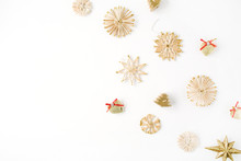 Creative Arrangement Of Bright Straw Christmas Toys On White Background. Flat Lay, Top View