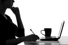 Silhouette Of A Woman Working In The Office