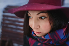 Close-up Portrait Of A Young Woman In A Wide-brimmed Hat With Daydreaming Romantic Expression