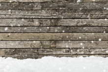 Snow On A Wooden Fence As Back...