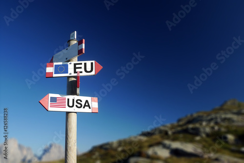 Fotografie, Obraz  USA and UE flags on mountain signpost