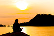 Silhouette, Woman Meditating in Yoga pose or Lotus Position by t