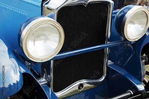 Fototapety, obrazy: Dark blue vintage car on a festival of old cars. Retro car's headlight close up.