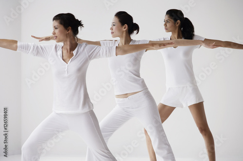 Obraz Three woman in lunge posture, yoga - fototapety do salonu