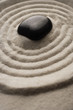 closeup of zen garden pebble detail on raked sand