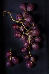 black grape fruit on a black background