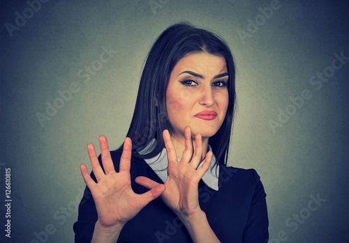 Fotografia, Obraz  Young woman with disgusted expression dodging something