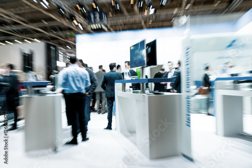 Stampa su Tela  blurred business people trade fair stock photo