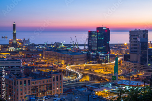 In de dag Barcelona GENOA, ITALY OCTOBER 30, 2016 - Industrial area near the port with Lanterna and commercial skyscrapers at sunset