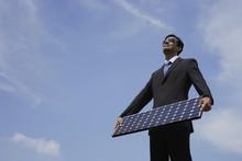 Businessman Holding Solar Panel.