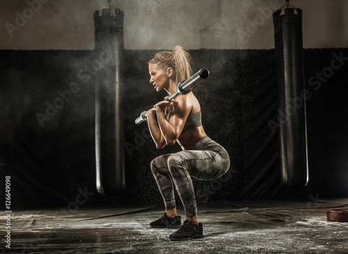 Fotografie, Obraz  sporty girl squats with barbell training