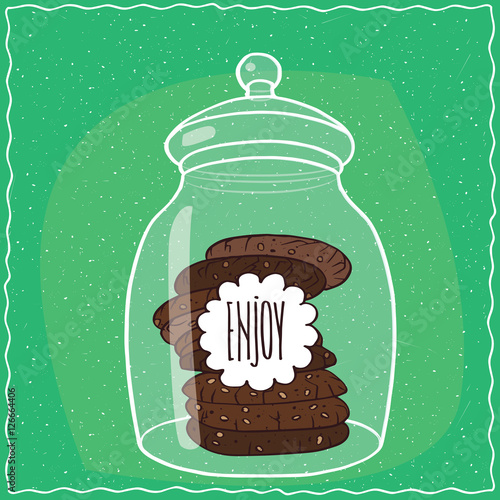 Canvas Print Large transparent glass jar with stack of round chocolate cookies inside