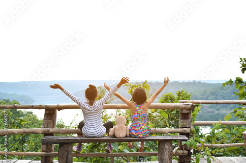 Photo Stands Nice Happy asian children with teddy bear in nature ,relax time on ho