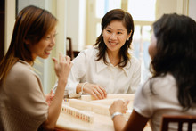 Women Sitting Around Mahjong Table