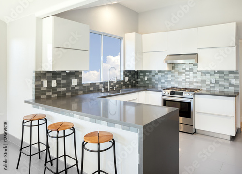 Swell Modern Kitchen In White With Bar Stools And Grey Counter Top Alphanode Cool Chair Designs And Ideas Alphanodeonline