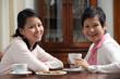 Mother and daughter enjoying tea together