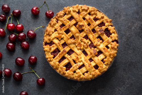 Photo  homemade cherry pie on the table .