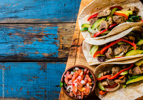 Fotografie, Obraz  Mexican pork tacos with vegetables. Top view