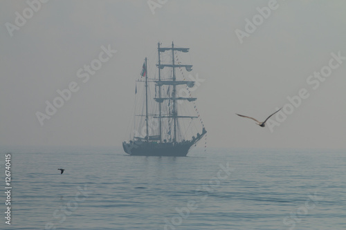 Keuken foto achterwand Schip Tall ship sailing in the sea in foggy misty day.