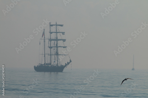 Foto op Plexiglas Schip Tall ship sailing in the sea in foggy misty day.