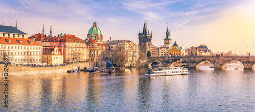 Photo  Prague panorama with its river and buildings - Panorama of Prague city, the capital of Czech Republic, with the Vltava river, the Charles Bridge and  surrounding buildings, on a sunny day of March