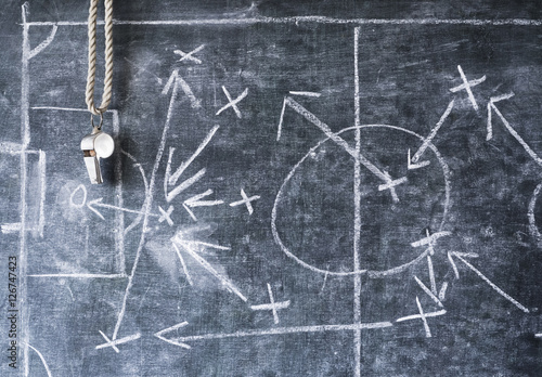 Fotografía  whistle of a soccer or football referee on black board with tactical diagram