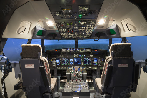 Leinwand Poster Cockpit of plane in flight simulator