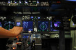 Hand on controller in cockpit of air plane in flight simulator