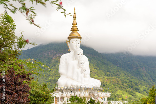 Photo  Five white Buddha image in Phetchabun, Thailand.