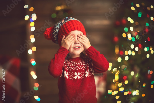 little girl  in anticipation of a Christmas miracle and a gift Canvas Print