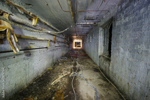 Photo Spooky Underground tunnel with asbestos pipework