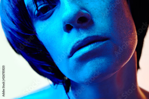 Fototapety, obrazy: beautiful woman with short black hair and blue light closeup