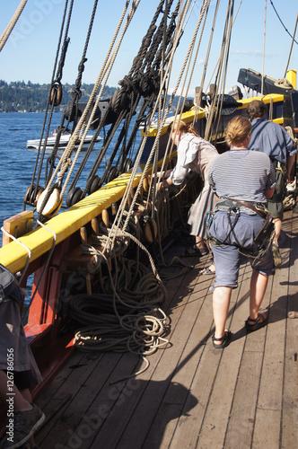 Fotografie, Obraz  The crew sets the sails of the Lady Washington