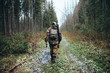 canvas print picture - Male hunter forest
