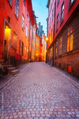 Photo  Gamla Stan narrow street illuminated at night, Stockholm, Sweden, toned