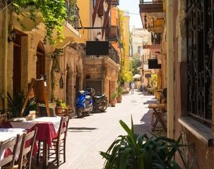 Fototapeta narrow street in Chania town on Crete island, Greece