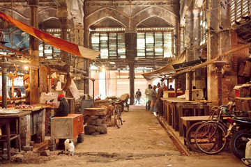 Obraz End of working day inside of grunge hall of old city market with historical counters