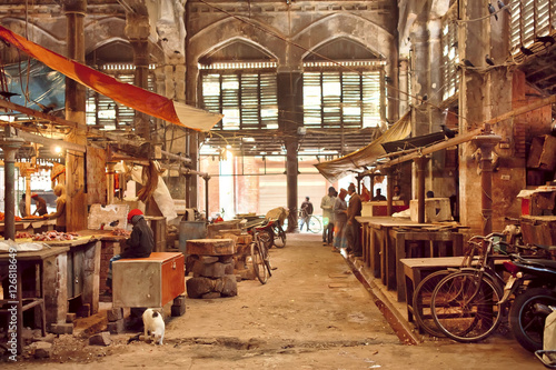 Foto op Plexiglas Fiets End of working day inside of grunge hall of old city market with historical counters