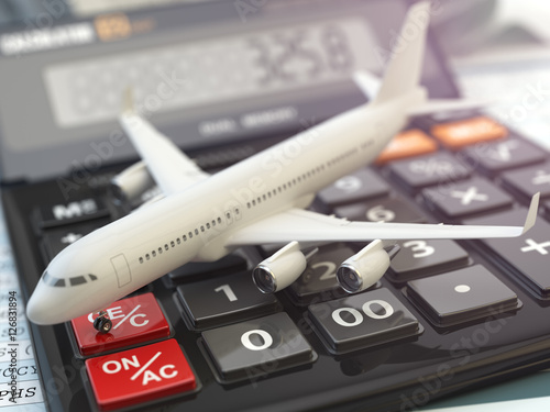 Photo  Travel cost calculation concept. Airplane and calculator. Cheape